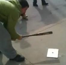 iPad getting smashed by baseball bat